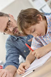 Teacher helping pupil with lesson Royalty Free Stock Photo