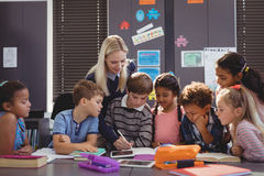 Free Teacher Helping Schoolgirl With Her Homework In Classroom Royalty Free Stock Photography - 93222277