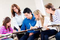 Teacher helping some students Stock Image