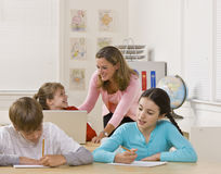 Teacher helping student Royalty Free Stock Photos