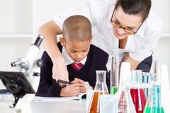 Teacher helping student Stock Image