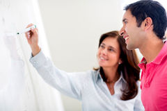 Teacher helping a student Royalty Free Stock Photo