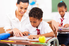 Teacher helping student Stock Photo