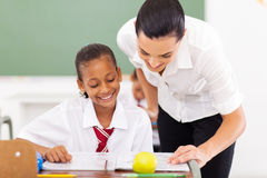 Teacher helping student Royalty Free Stock Photography