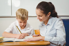 Teacher helping a student in class Royalty Free Stock Photos