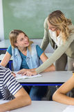 Teacher helping student in class Royalty Free Stock Photography