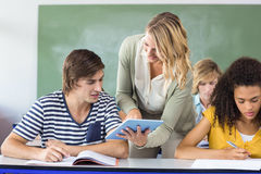 Teacher helping student in class Royalty Free Stock Photo