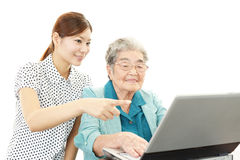 Teacher helping student on the computer stock photos