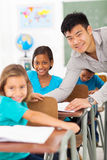 Teacher helping student Royalty Free Stock Photo