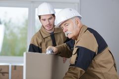 Teacher helping student training to be builders. Apprentice stock photography
