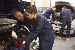 Teacher Helping Student Training To Be Car Mechanics Stock Photography
