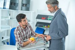 Teacher helping student training to be electrician royalty free stock image