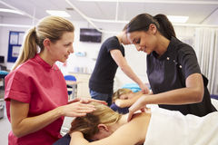 Teacher Helping Student Training To Become Masseuse Stock Images