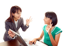 Teacher helping student use a computer Royalty Free Stock Image