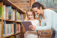 Teacher helping a student use a tablet Stock Image