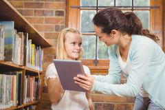 Teacher helping a student use a tablet royalty free stock photos