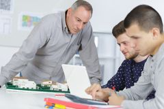Teacher helping the students. Teacher royalty free stock photography