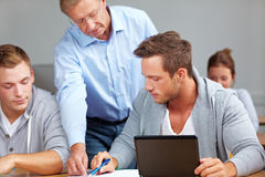 Teacher helping students learning Stock Photography