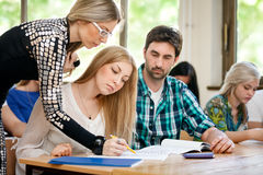 Teacher helping students Royalty Free Stock Photo