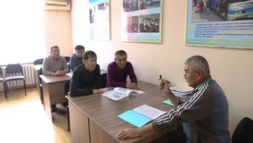 Business people working. Teacher helping students training, group of students study with professor in modern school classroom stock footage