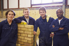 Teacher Helping Students Training To Be Builders Stock Photos
