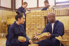 Teacher Helping Students Training To Be Builders royalty free stock photos