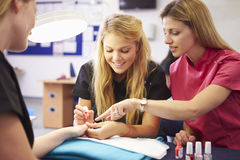 Teacher Helping Students Training To Become Beauticians Royalty Free Stock Photos