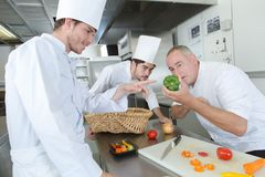 Teacher helping students training to work in catering royalty free stock image