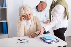 Teacher helping worried aged female Stock Photography