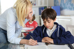 Teacher with kids at school Stock Photography