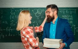 Teacher helping young student with lesson. Nerd funny student preparing for university exams. Concept of education and. Teaching. Studying at university stock image