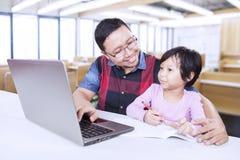 Teacher helps female student to study Stock Photos