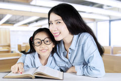 Teacher helps her student to study in class Royalty Free Stock Images