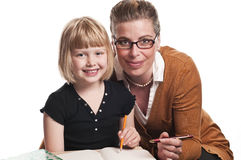 Teacher helps young schoolgirl Royalty Free Stock Photography