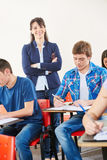 Teacher with her arms closed Royalty Free Stock Photos