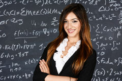 Teacher. In her classroom ready to teach students Stock Photography