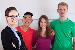 Teacher with her multi-ethnic students. Portrait of a teacher with her multi-ethnic students Stock Image