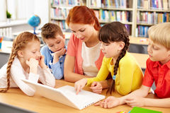 Teacher and her pupils royalty free stock images