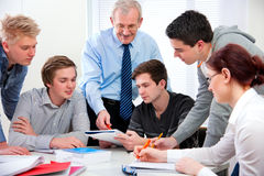Teacher with high school students Royalty Free Stock Images
