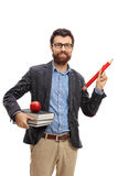 Teacher holding a big pencil and a stack of books Royalty Free Stock Images