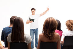Teacher holding book Stock Photo