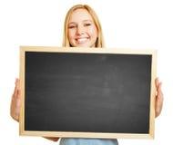Teacher holding empty black chalkboard Royalty Free Stock Image