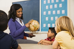 Teacher Holding Globe Stock Photography