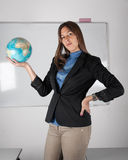 Teacher holding globe in hand Royalty Free Stock Photo