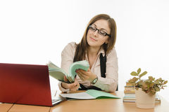 The teacher is holding a notebook students Stock Photography