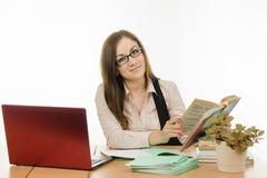 The teacher is holding a textbook Stock Photos