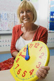 Teacher Holding A Time Teaching Clock Stock Images