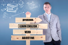 Teacher holding a wooden sign learn English Royalty Free Stock Images