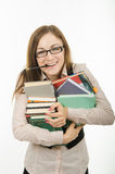 The teacher holds a pile of textbooks and notebooks Stock Photography