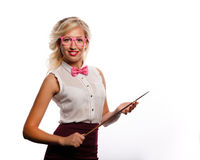 The teacher holds pointer. The teacher holds a pointer. The girl is dressed in a blouse, a bow tie and glasses. Training. Positive look into the future. Back to royalty free stock photo